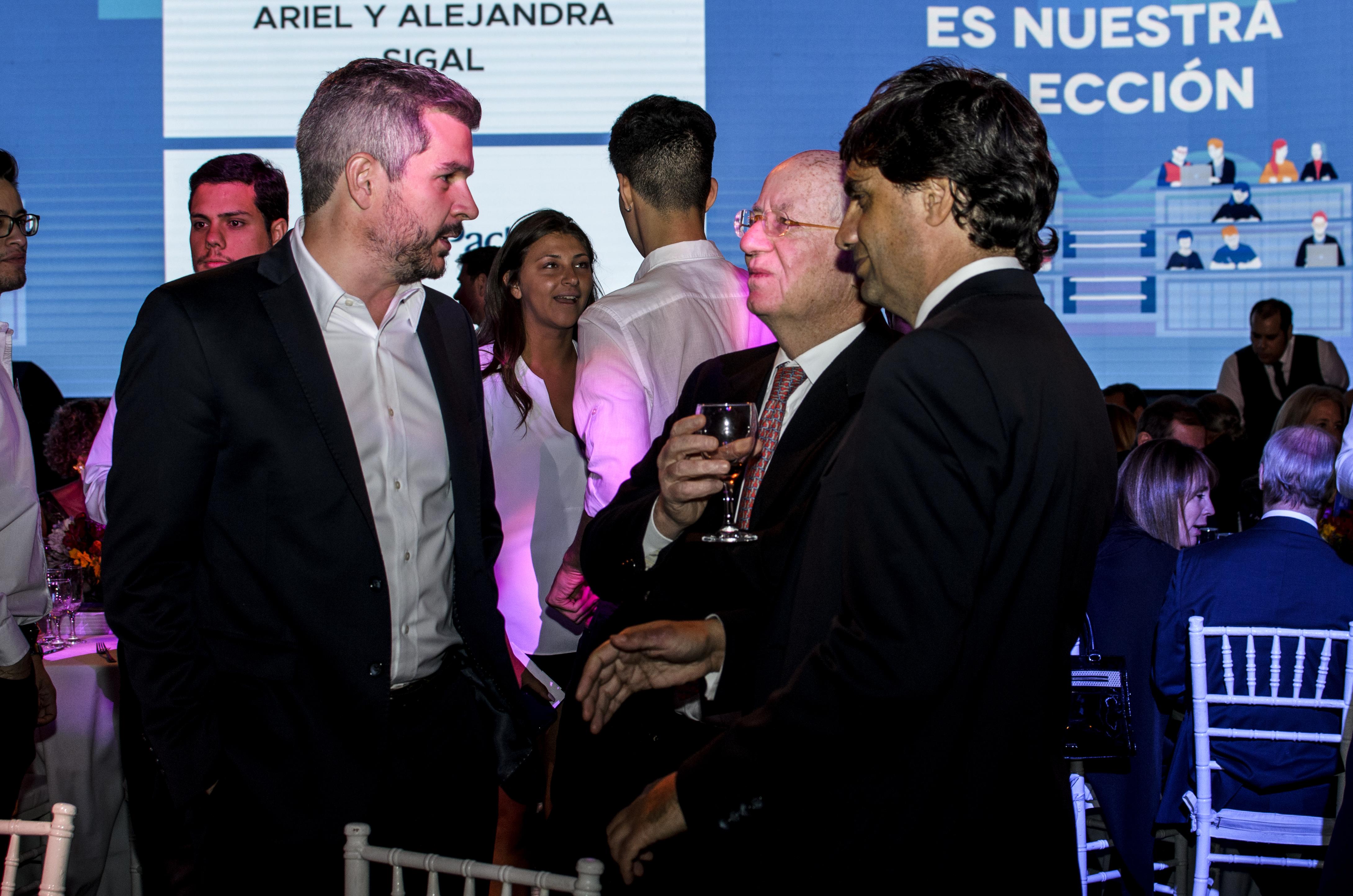 Marcos Peña junto al empresario Paolo Rocca (Techint) y Hernán Lacunza