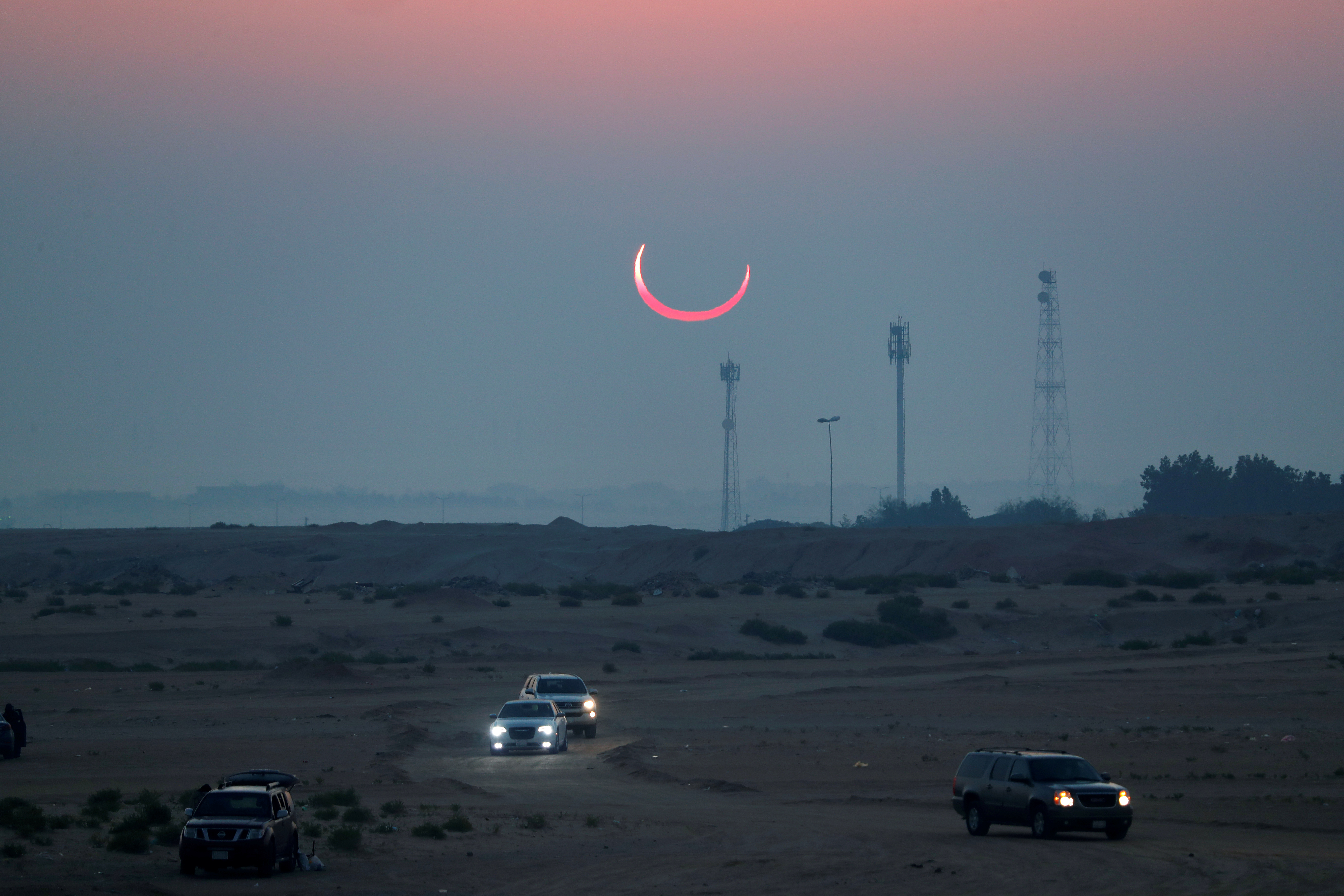 eclipse observed in desert in Hofuf, Saudi Arabia.
