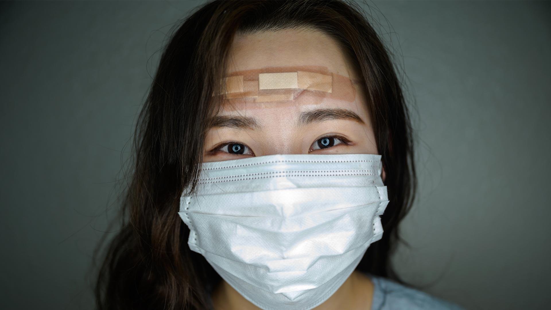 Los rostros de las enfermeras de Corea del Sur que luchan contra el coronavirus (Foto: Ed Jones/AFP)