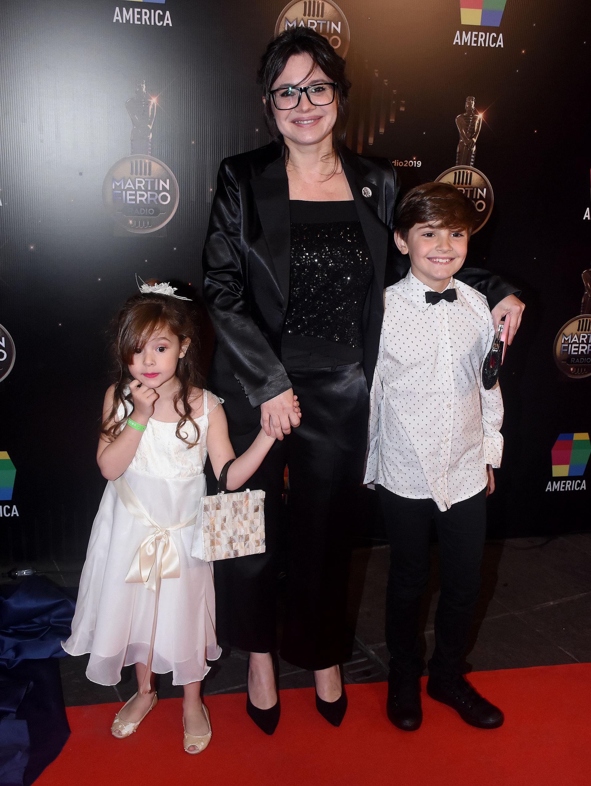 Gisela Marziotta, junto a sus hijos