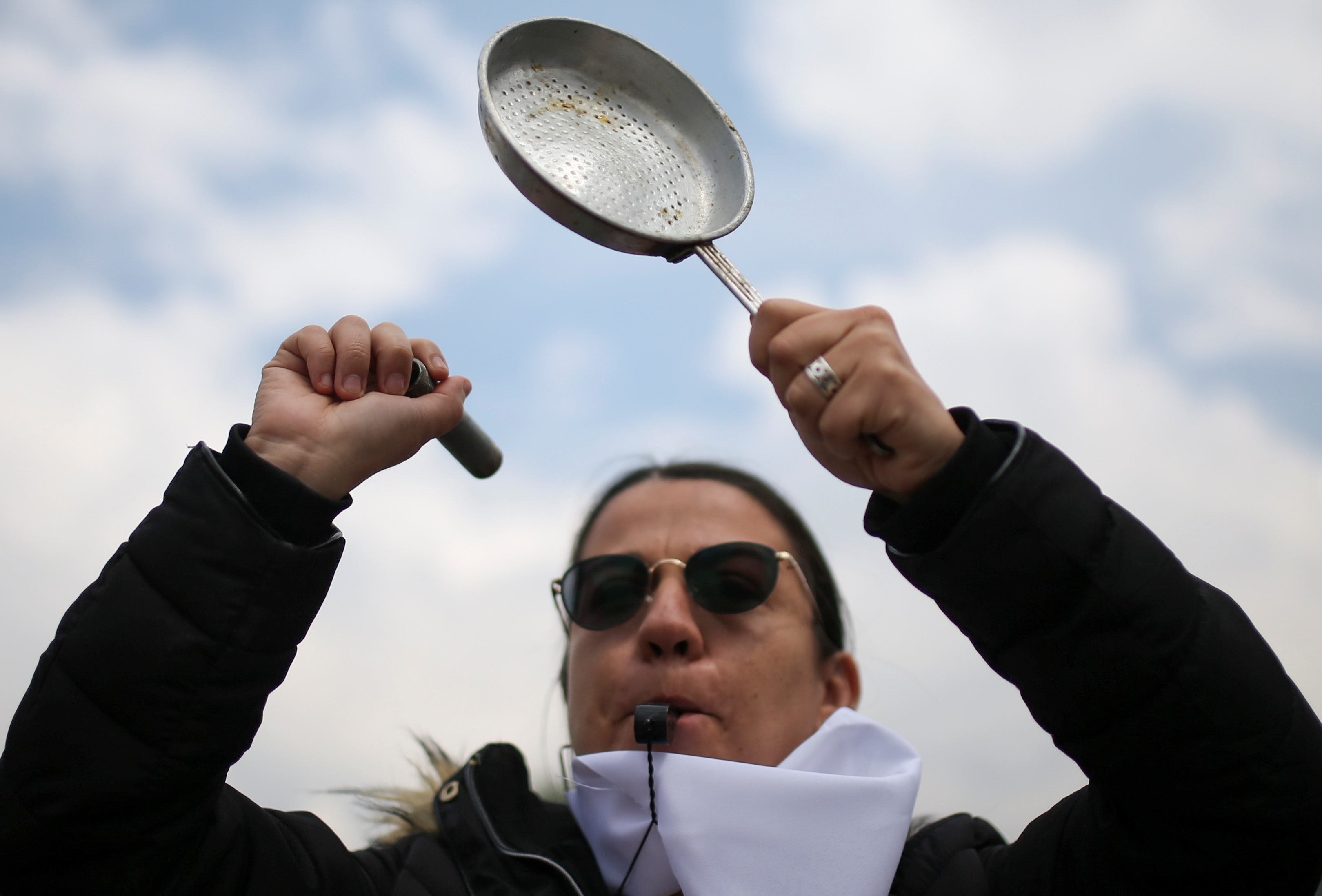 A demonstrator bangs a pot during a protest for a national strike, in Bogota, Colombia, November 21, 2019. REUTERS/Luisa Gonzalez