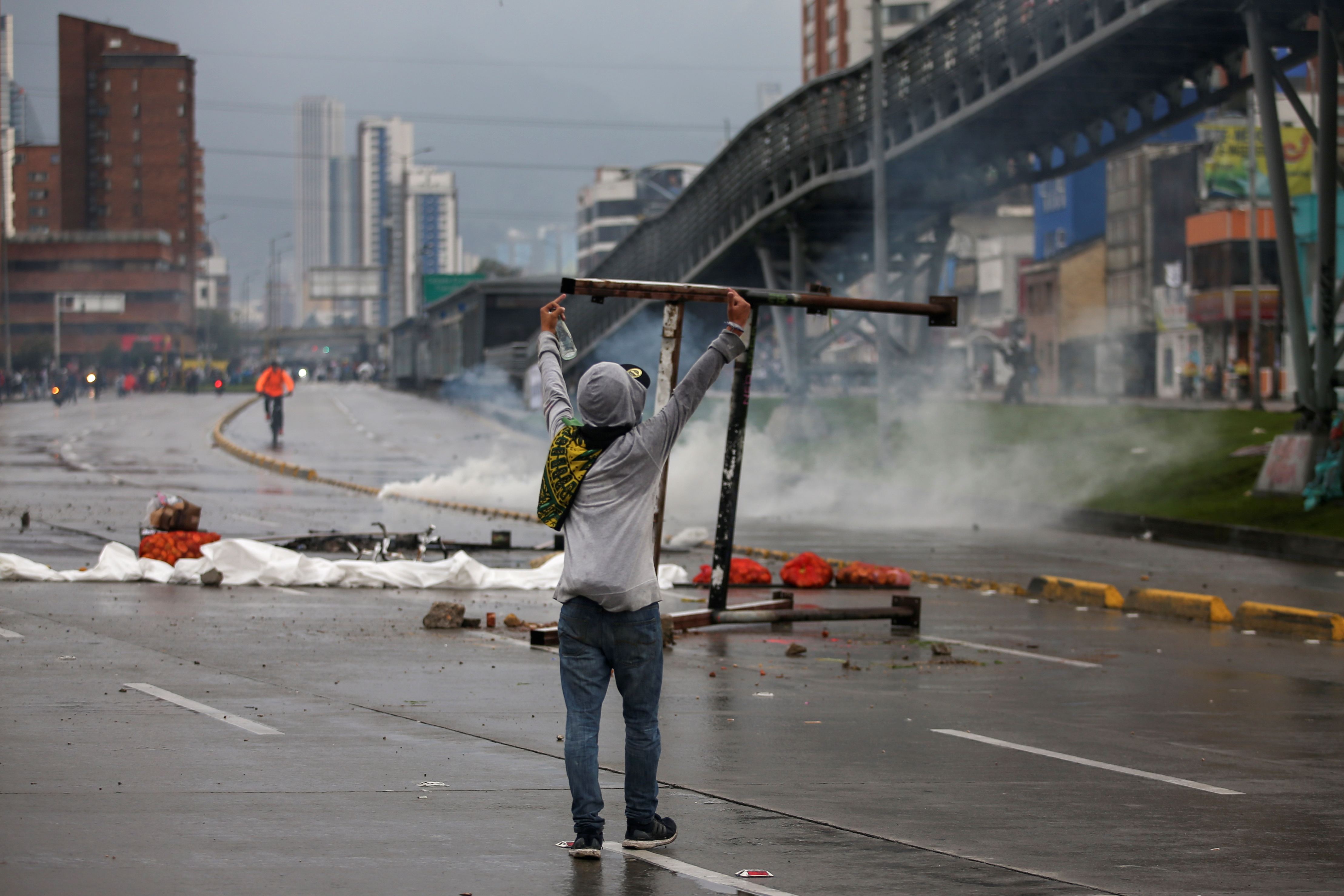 A demonstrator gestures to riot police during a protest in Bogota, Colombia, November 21, 2019. REUTERS/Luisa Gonzalez