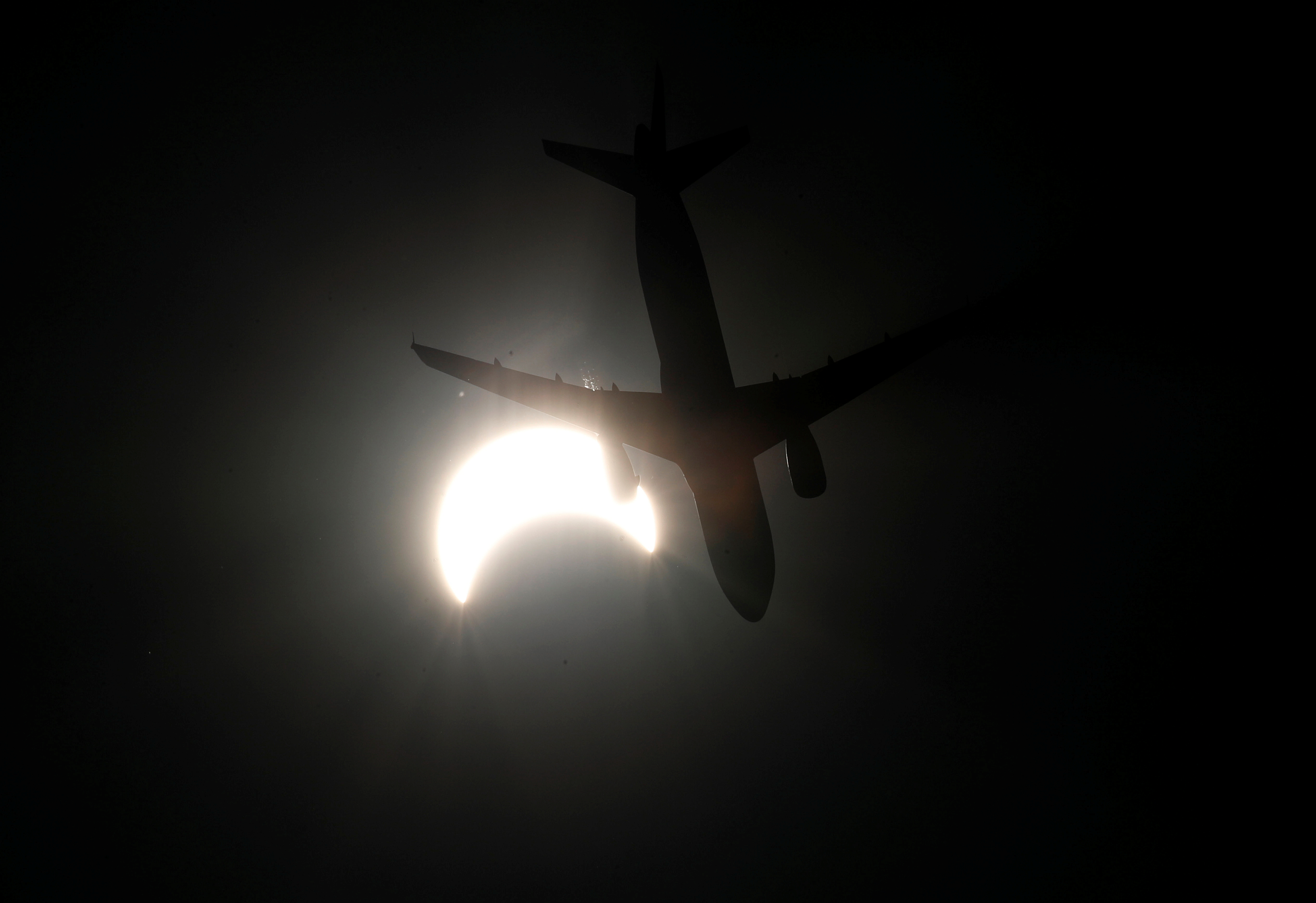 Flight in the sky of Bangkok, Thailand, solar eclipse.