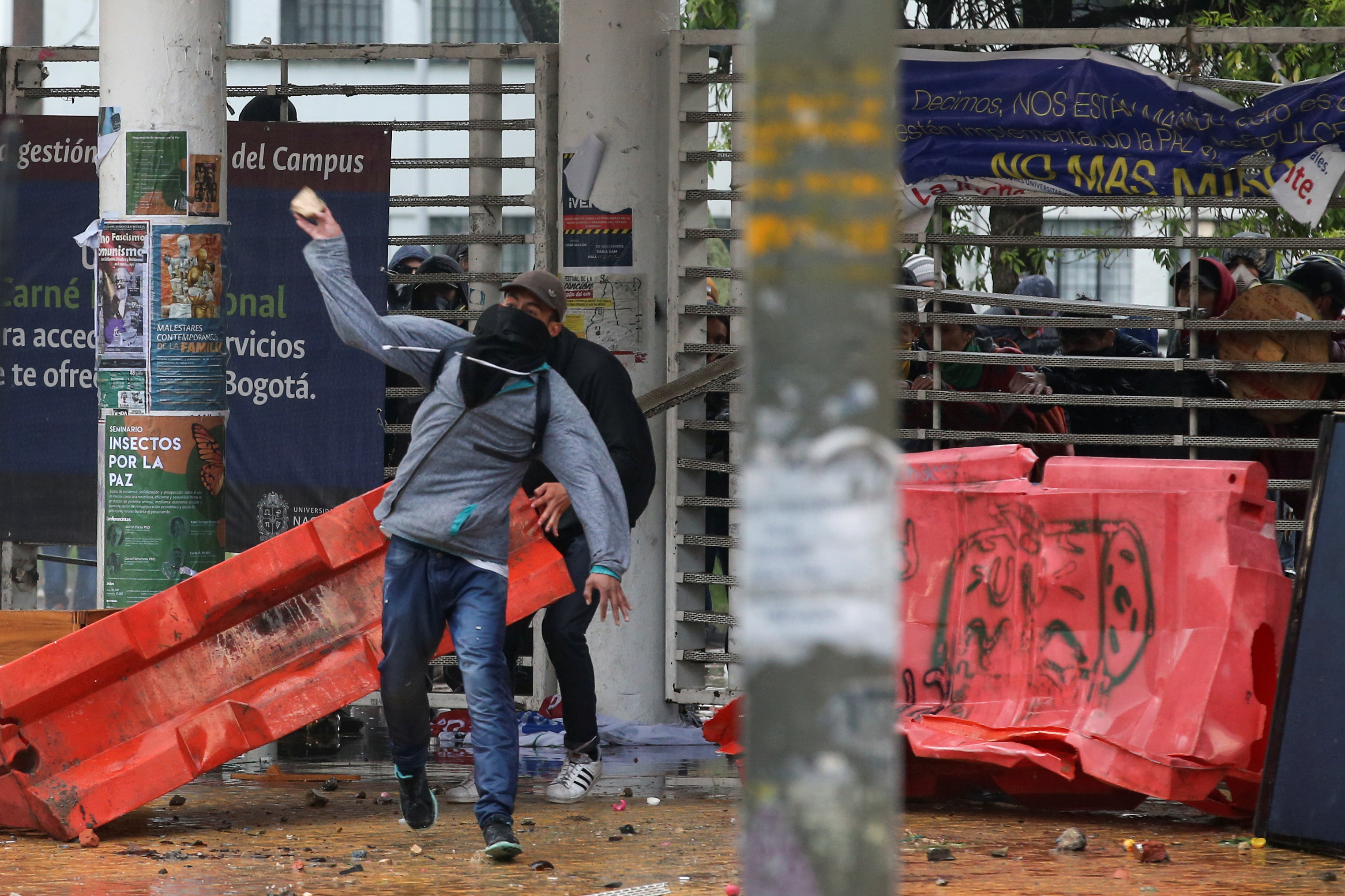 A demonstrator throws a stone during a protest in Bogota, Colombia, November 21, 2019. REUTERS/Luisa Gonzalez