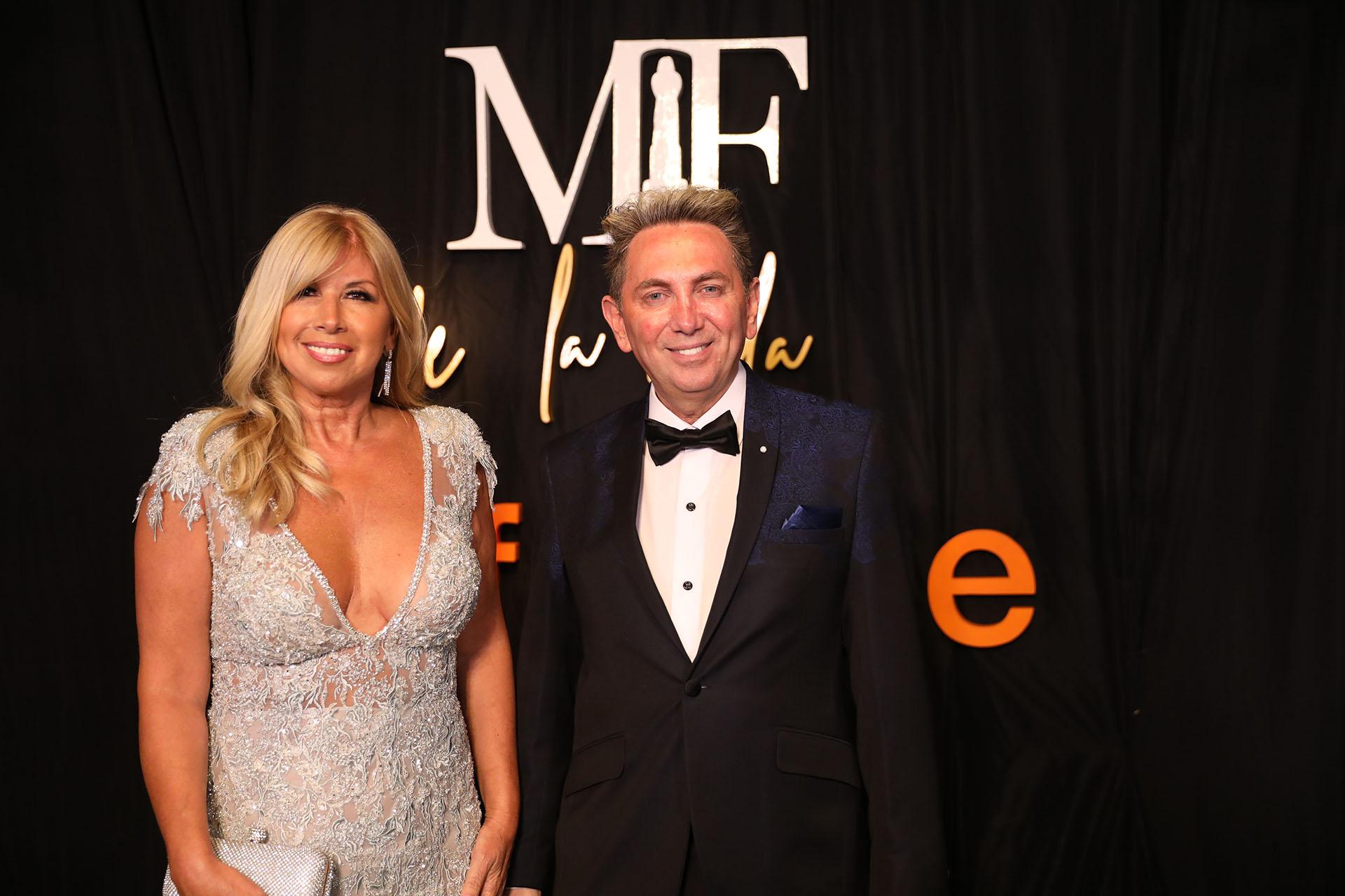 Claudia Arce con un diseño de su propia marca y Daniel Casalnovo con un traje de su firma