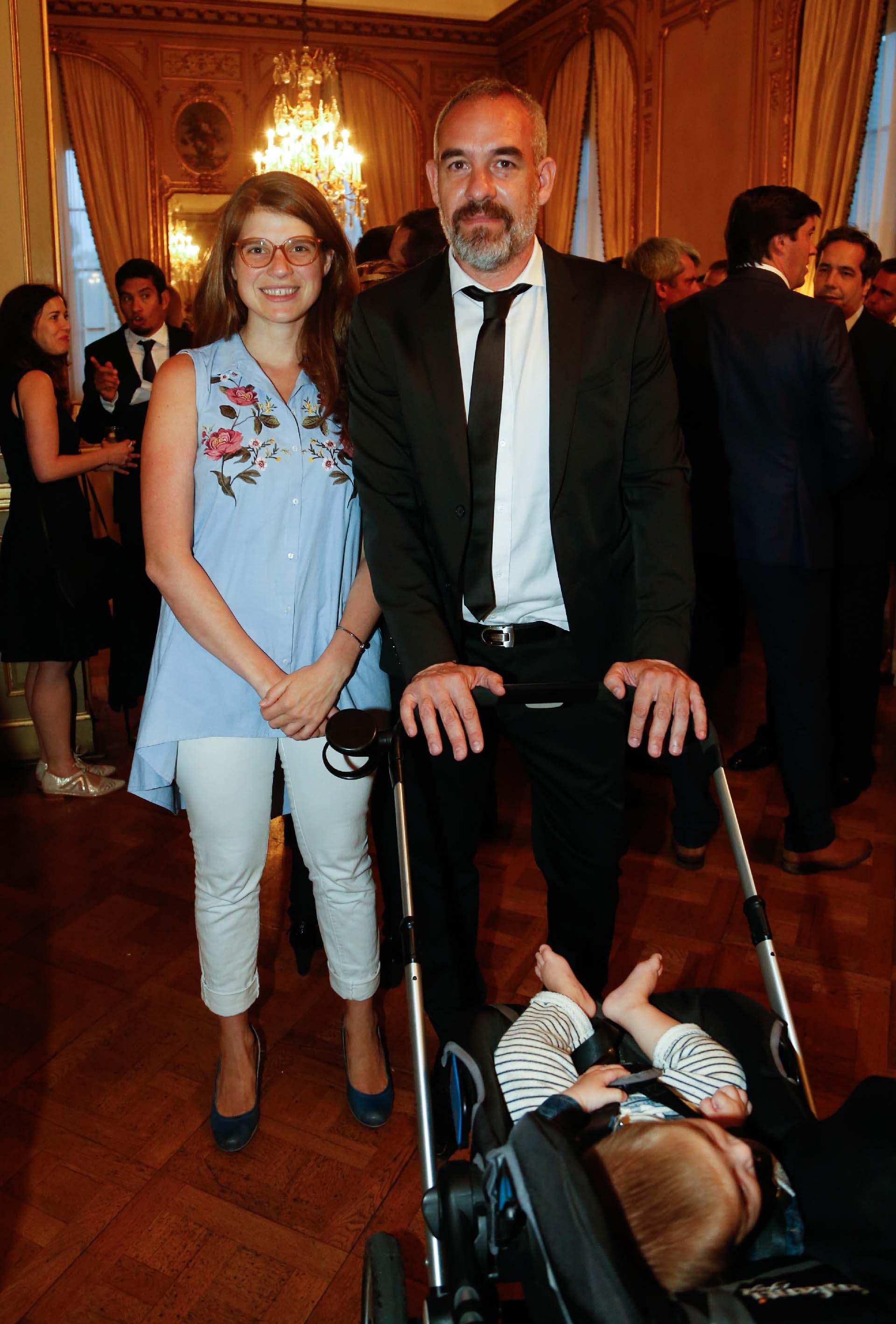 Los economistas Delfina Rossi y Sergio Woyecheszen junto a su hijo Noah